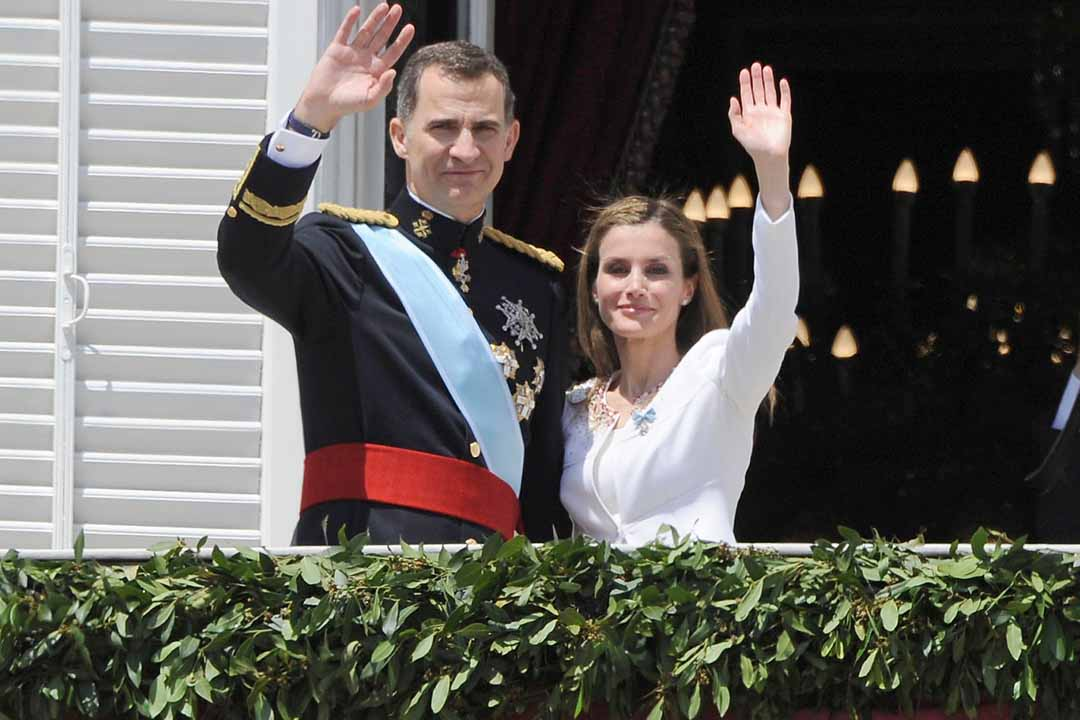 Spanish King Felipe VI and Queen Letizia salute on the balcony of the Royal Palace as part of the celebration of the investiture of Spain Crown Prince Felipe of Borbon and Greece as King in Madrid , Spain , on Thursday 19th June 2014 , Madrid